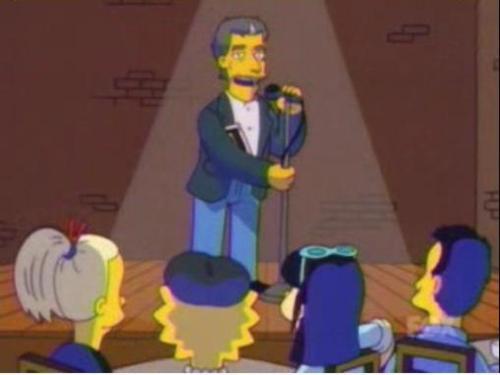 Robert Pinsky leest 'Impossible to tell' voor. Lisa draagt een baret.